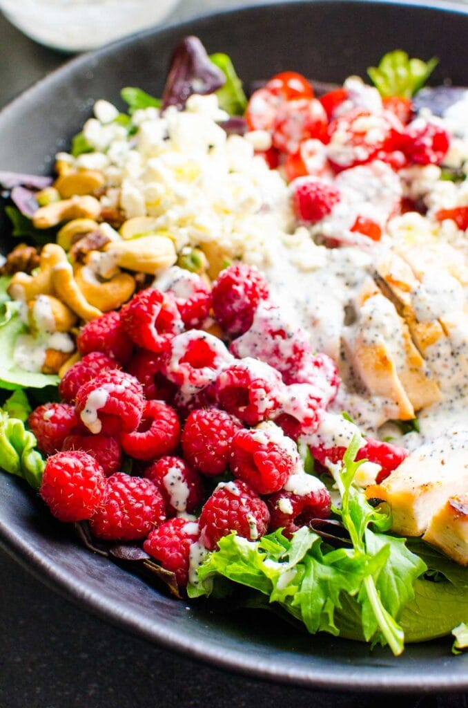 side of best grilled chicken salad recipe with dressing and fruits and nuts