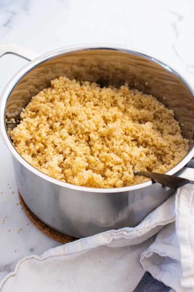 quinoa in pot with towel around bottom