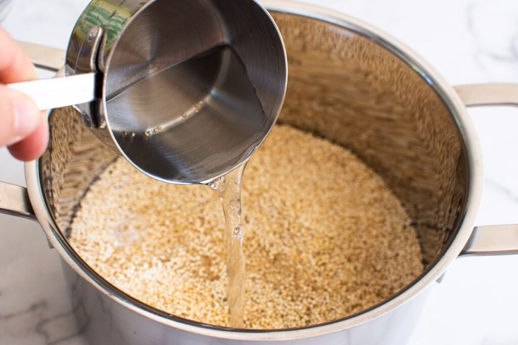 adding water to quinoa