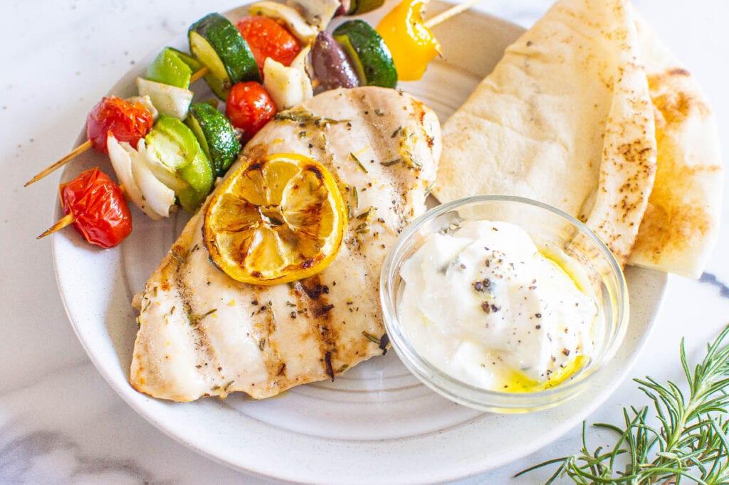 lemon rosemary chicken breast with pita veggies and tzatziki sauce