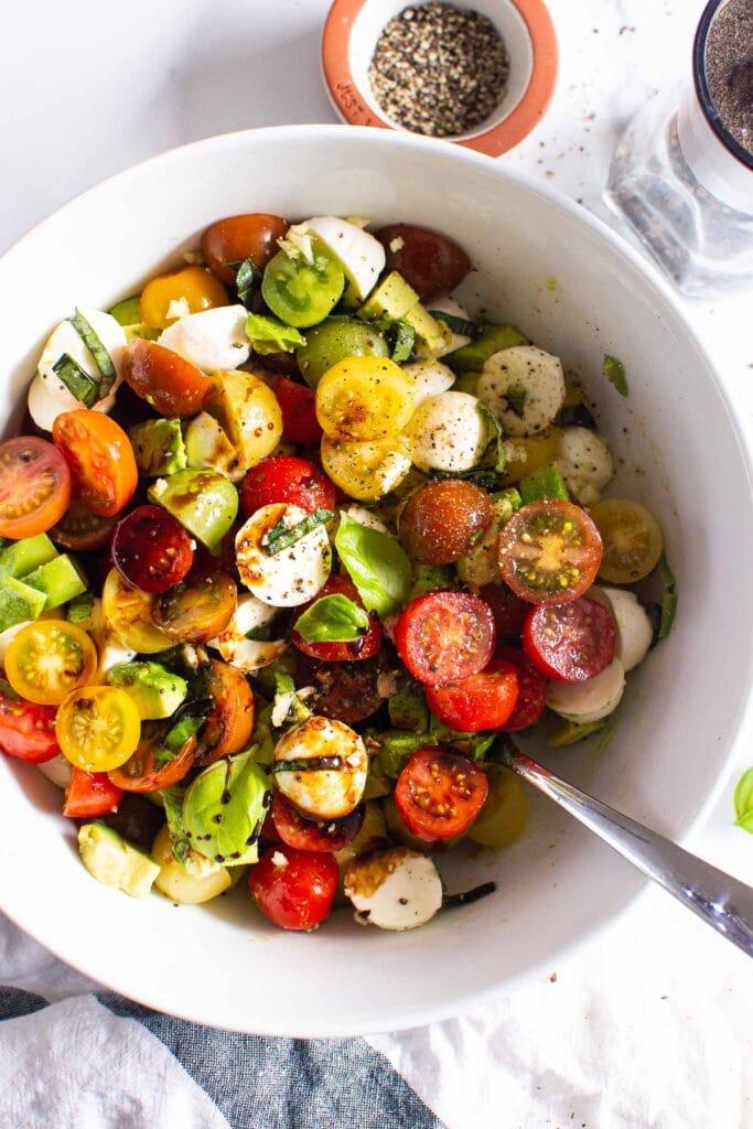 tomato mozzarella salad serving spoon