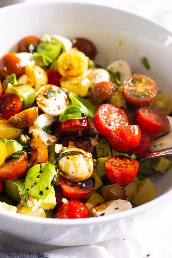 tomato mozzarella salad featured in a bowl
