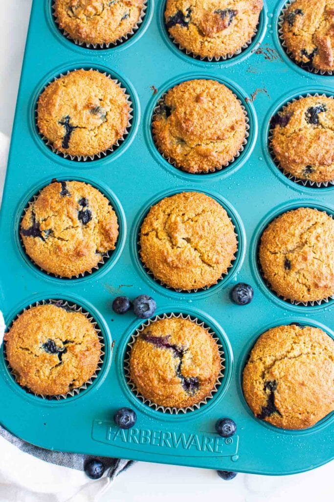 almond flour muffins with blueberries in blue muffin tin