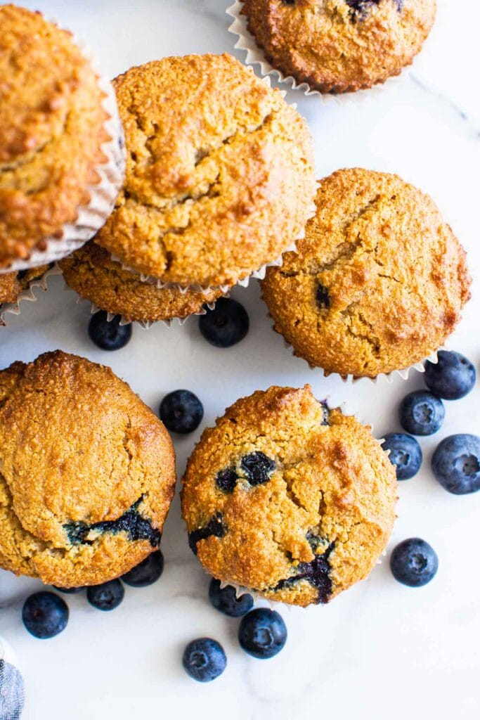 blueberry muffins with almond flour pictured from above with fresh blueberries