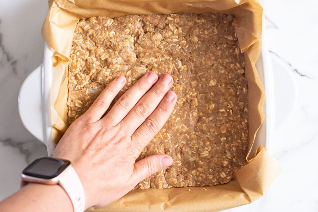 placing the oat layer in bottom of pan