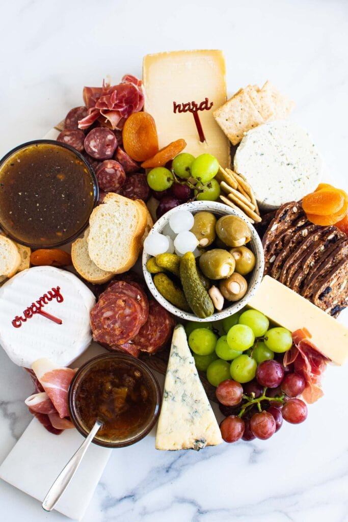 everyday simple charcuterie board with meats and cheese fruits on board