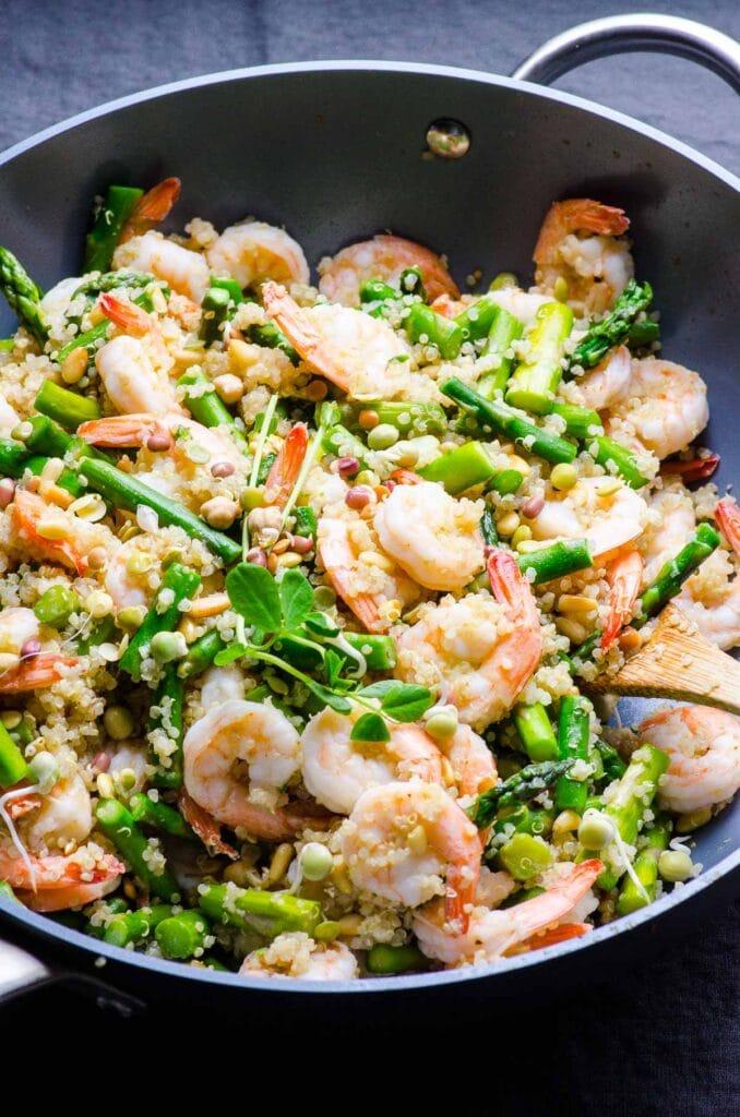 garlic butter shrimp quinoa asparagus in a skillet