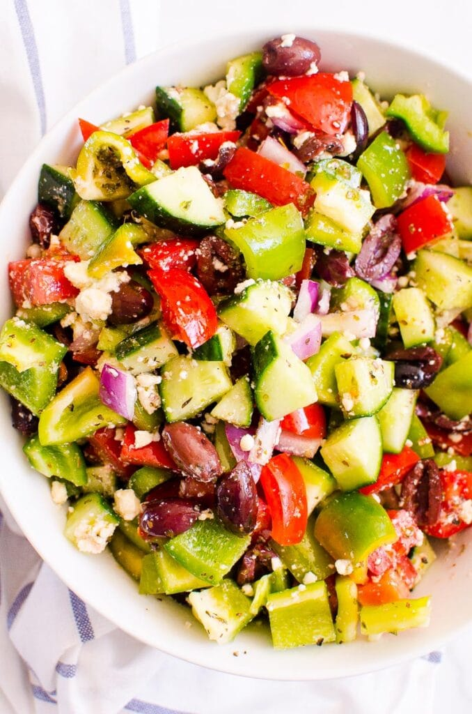 greek salad with tomato cucumber feta in a large salad bowl