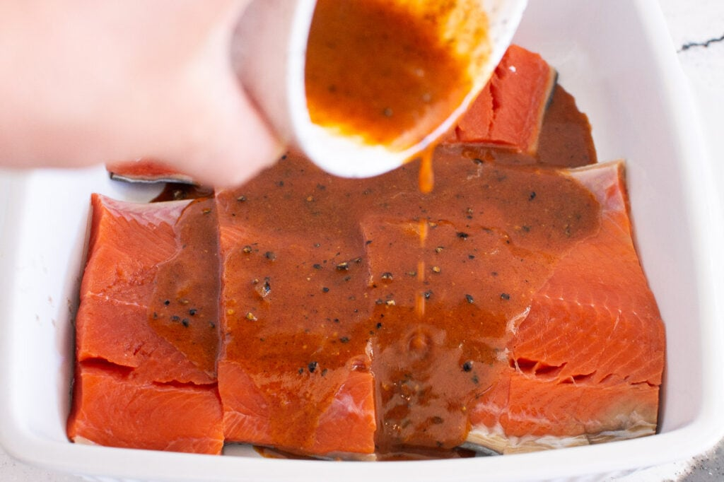 grilled salmon marinating in dish