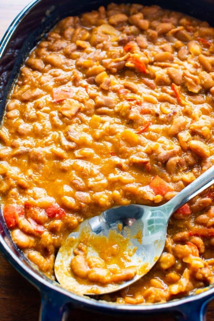 instant pot baked beans with metal spoon