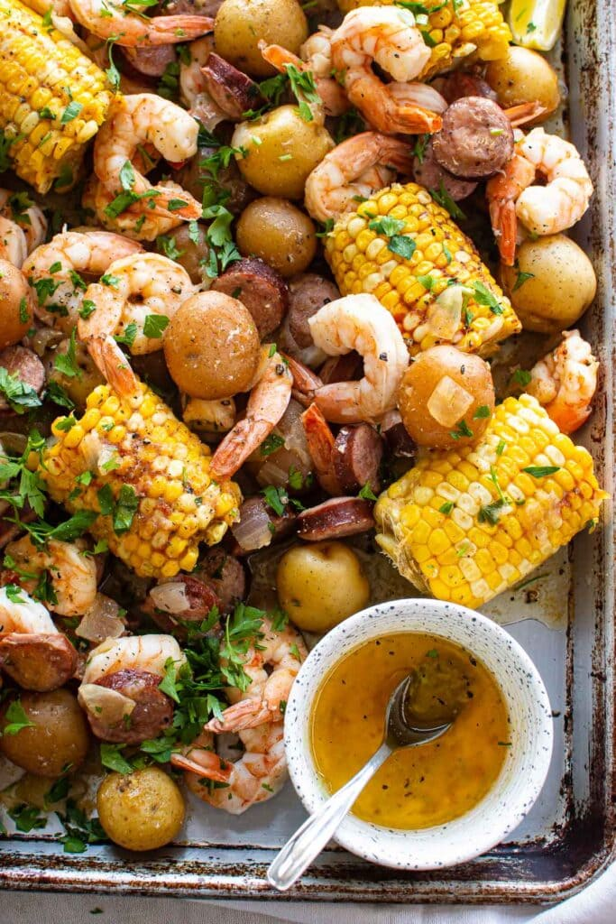 instant pot shrimp boil with corn on a platter with sauce