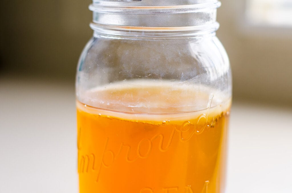 scoby and kombucha in a glass jar