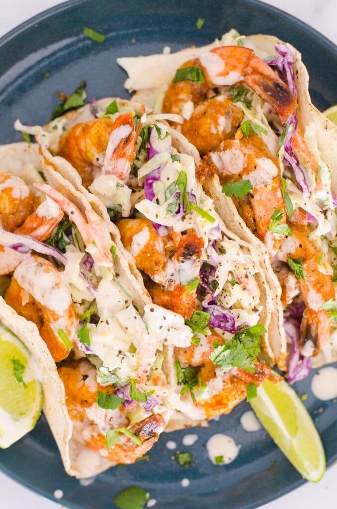 shrimp tacos with lime taco sauce and slaw