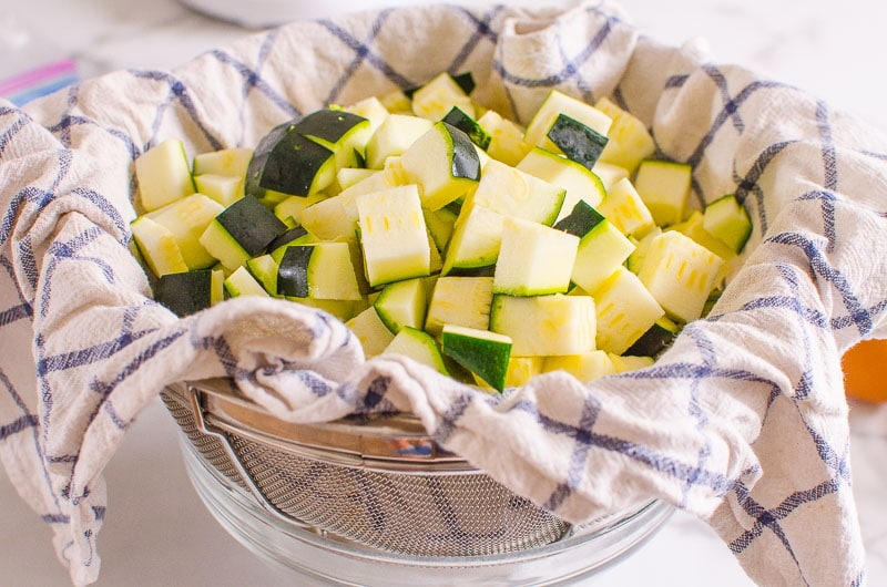 zucchini on a towel in colander