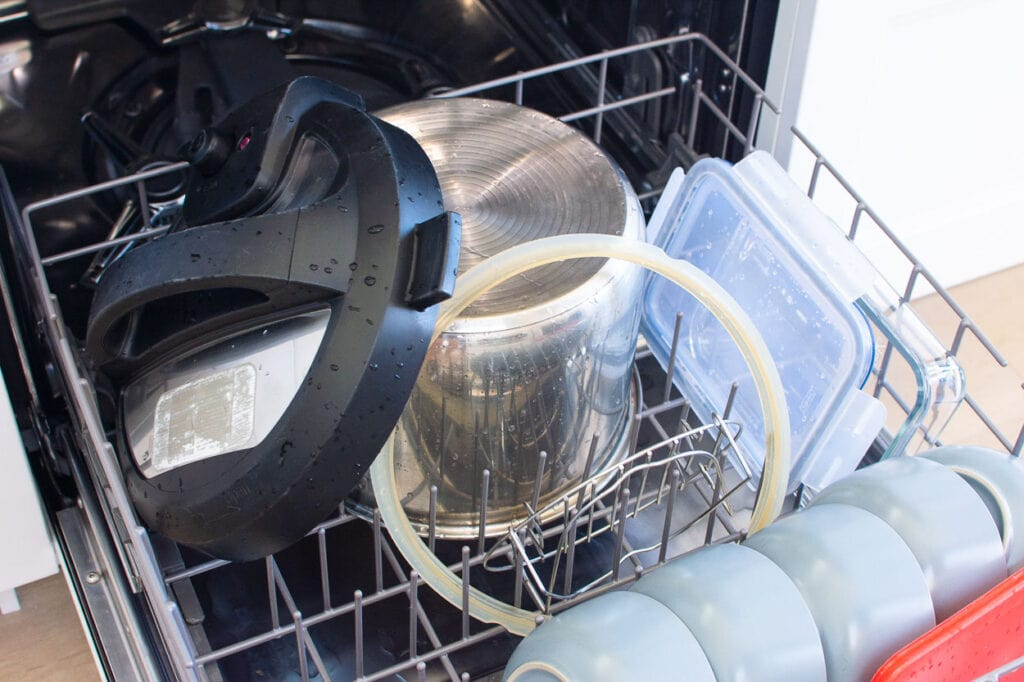 instant pot lid, pot, silicoen ring and trivet in a dishwasher