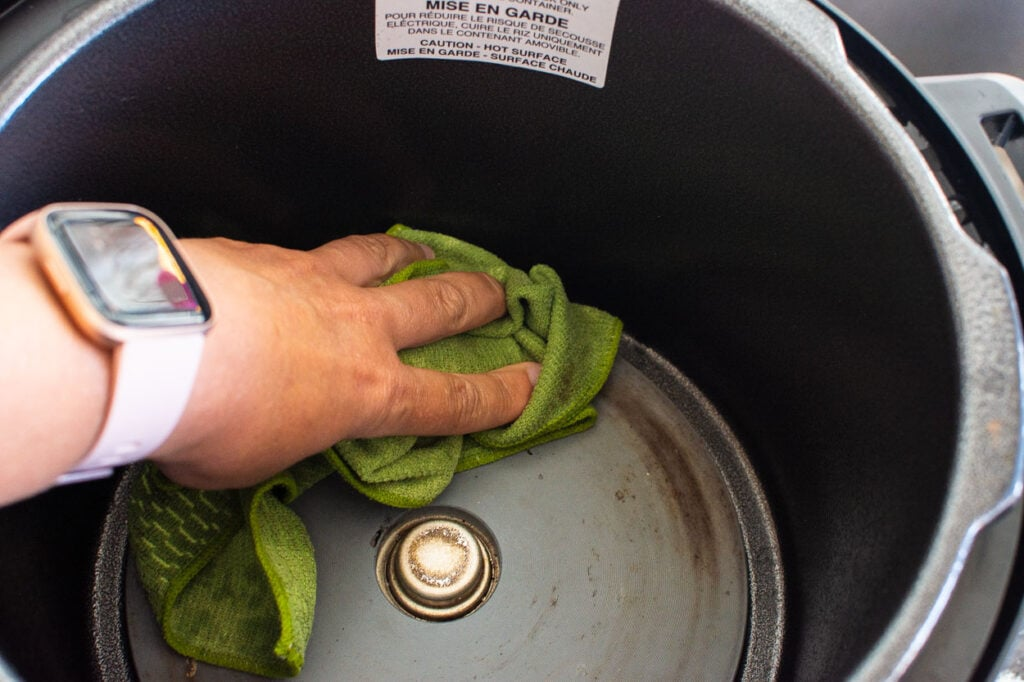 cleaning inside instant pot with cloth