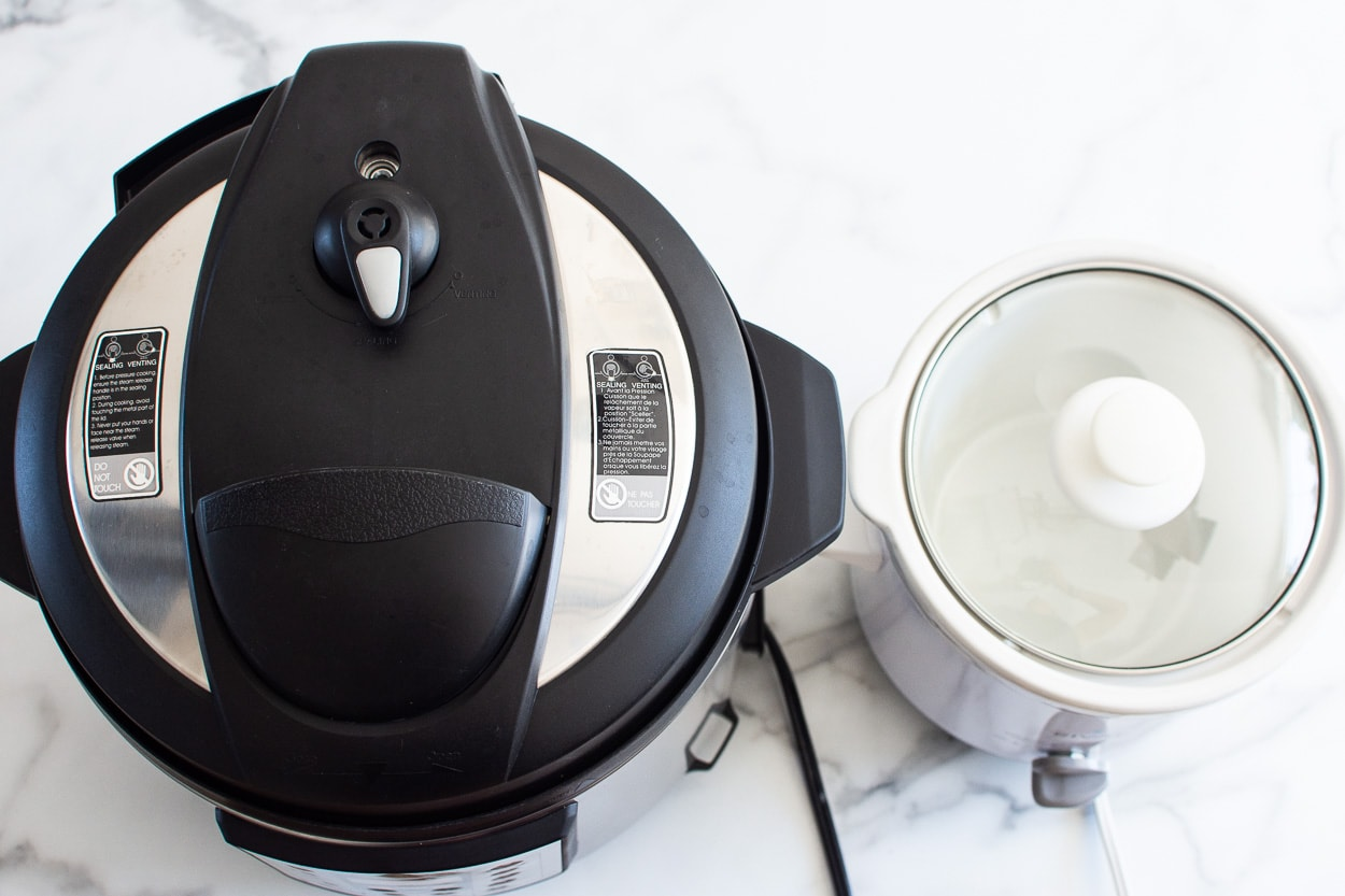 instant pot and slow cooker on kitchen counter