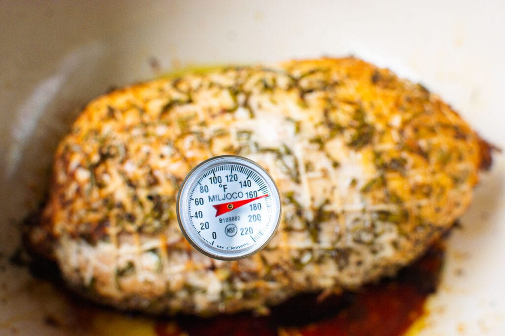 turkey breast with thermometer showing internal temp after resting