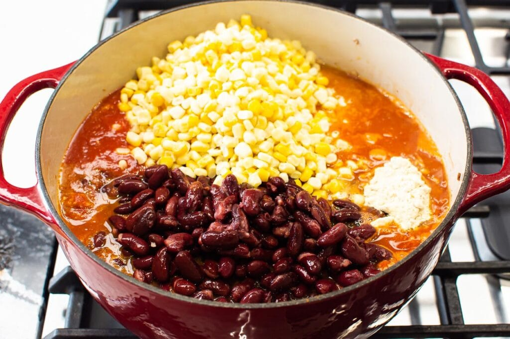 beans and corn being added to turkey taco soup