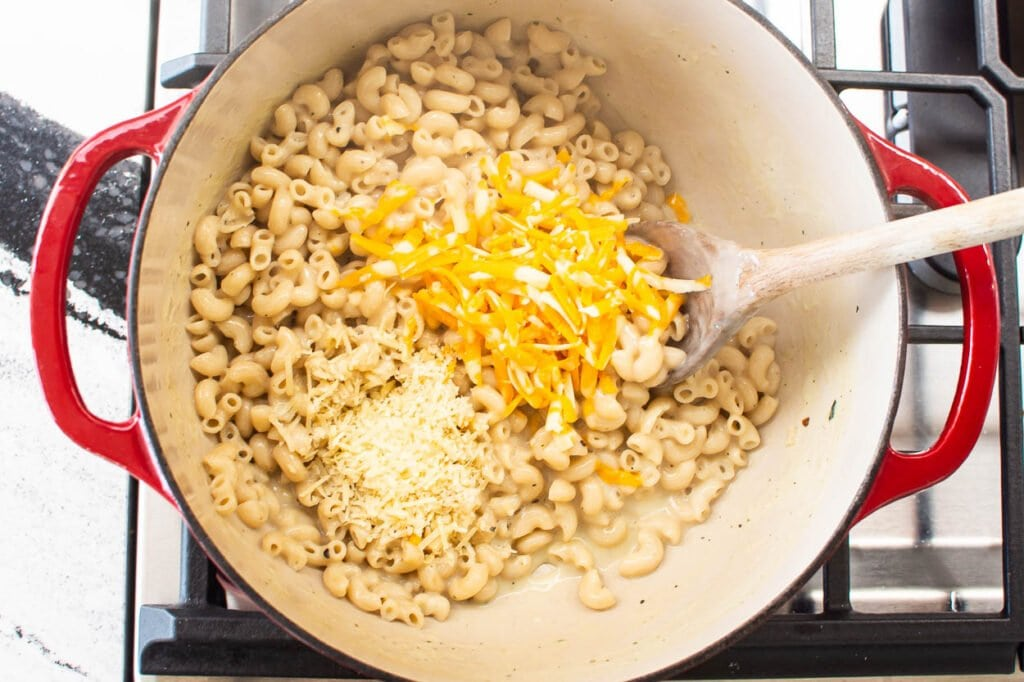 adding cheese to healthy macaroni and cheese