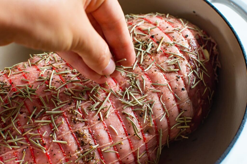 sprinkling roast with herbs and spices