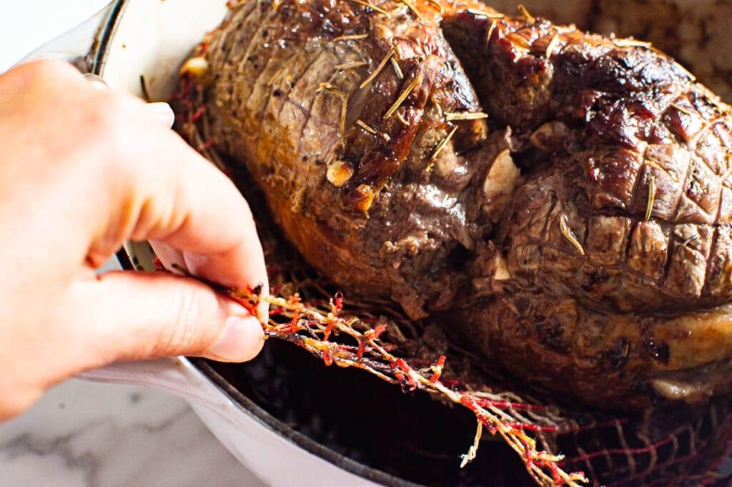 removing mesh from lamb roast