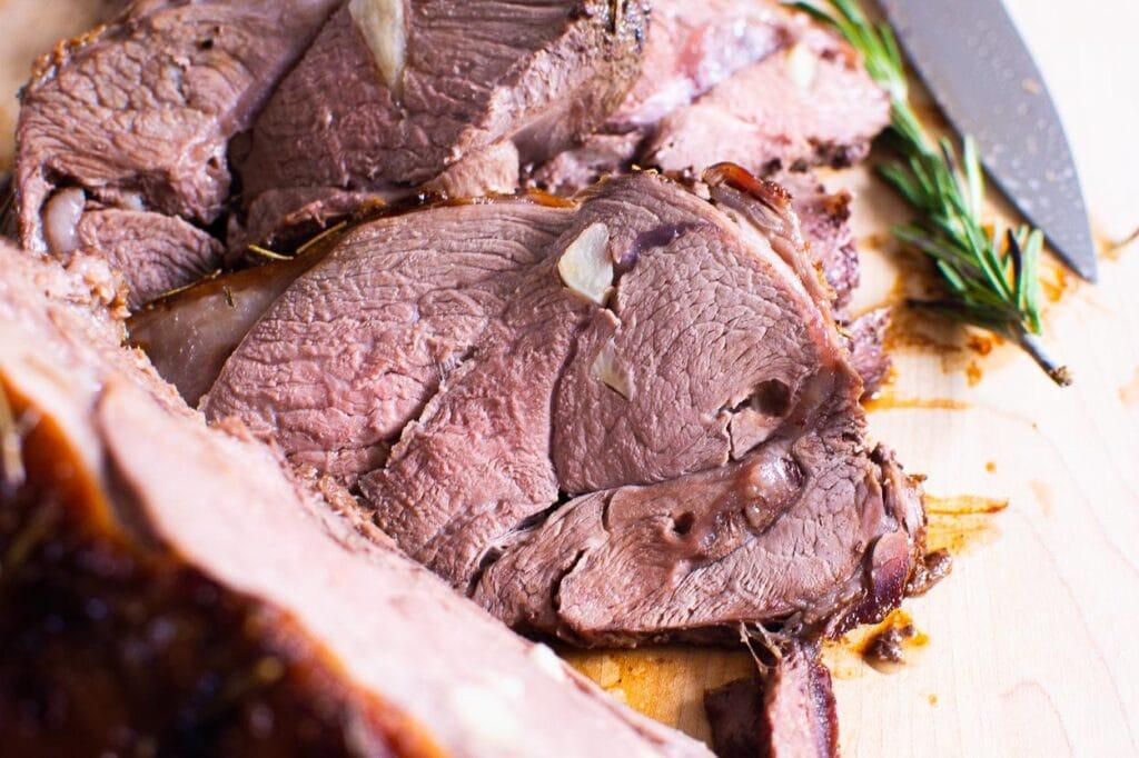 sliced lamb roast on a cutting board