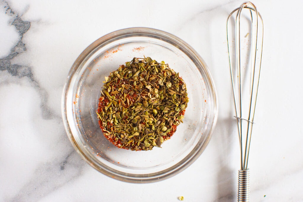 herbs and spices whisked in small glass bowl