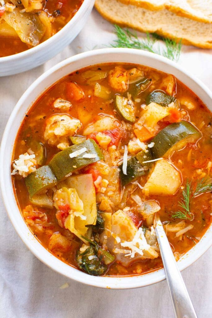 vegetable soup instant pot in bowls with crusty bread and parmesan