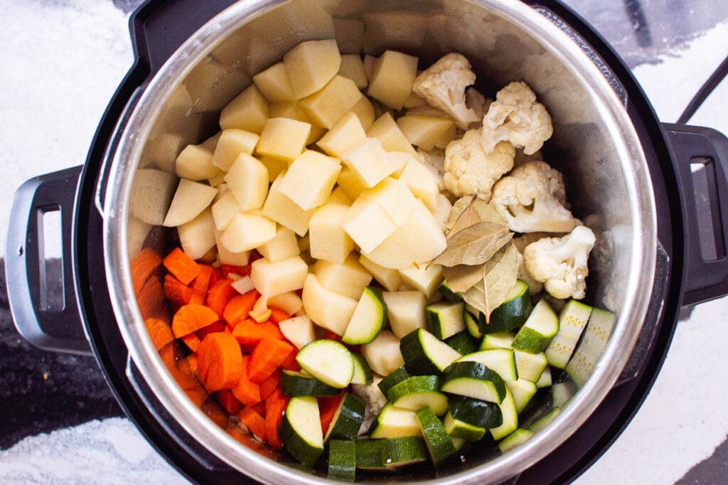 vegetables and bay leaves in instant pot