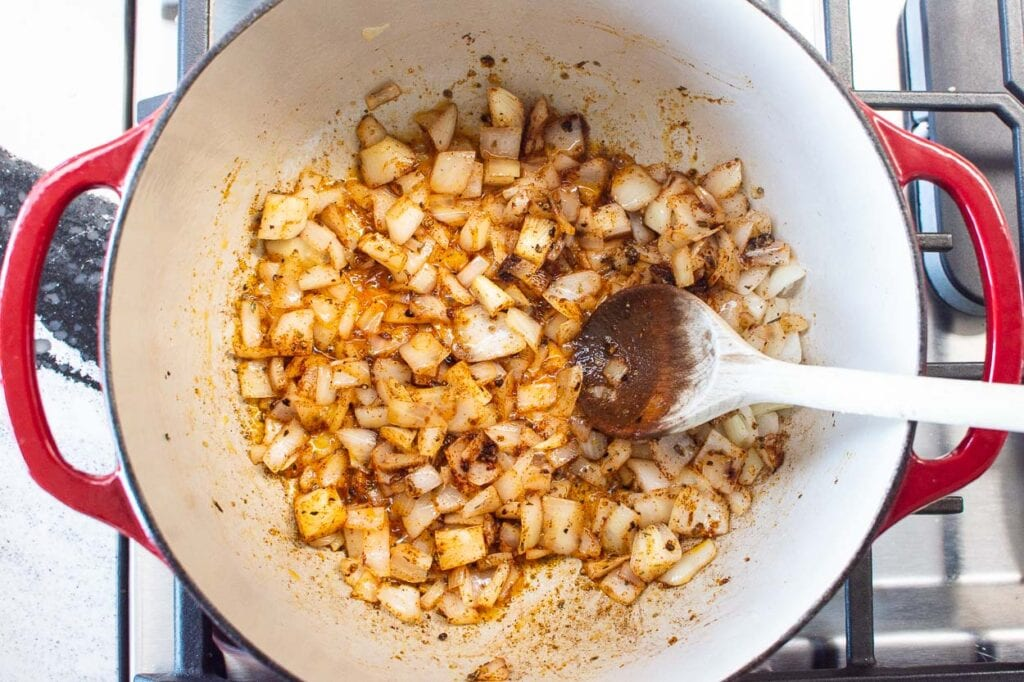 sautéing onion and spices in pot on stovetop